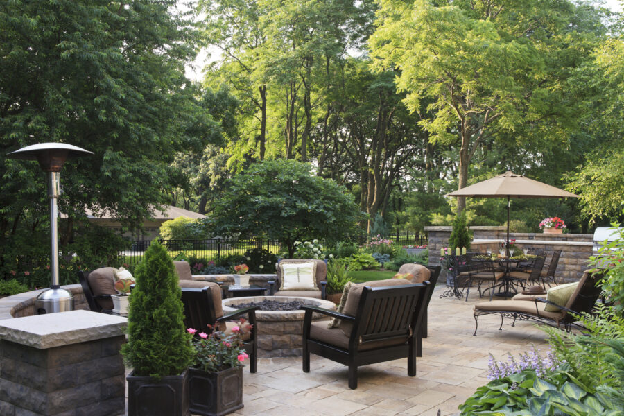 Large garden patio and gathering space with covered seating and fire pits