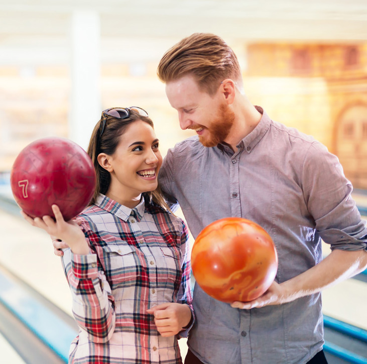 man and woman couple bowling